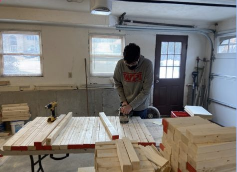 Senior Will Merry working on his desk-building project.