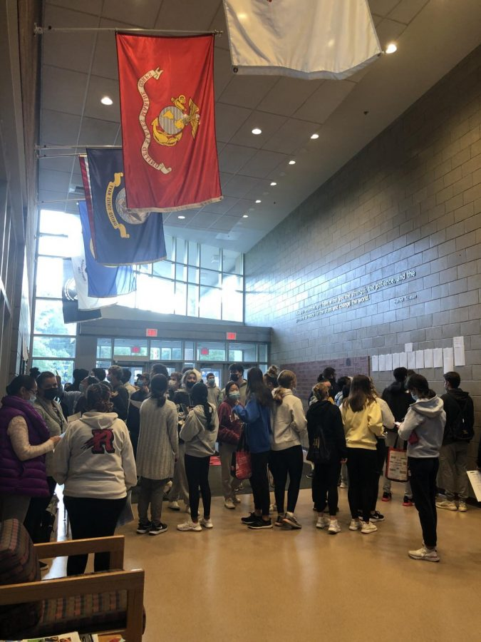 Students+gather+in+the+RMHS+lobby+before+starting+the+SAT.